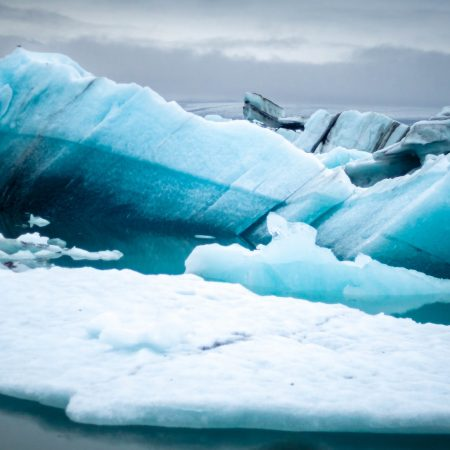 icebergs floating on water in lagoon